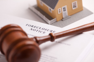 Foreclosure Notice, Gavel and Model Home with Selective Focus.